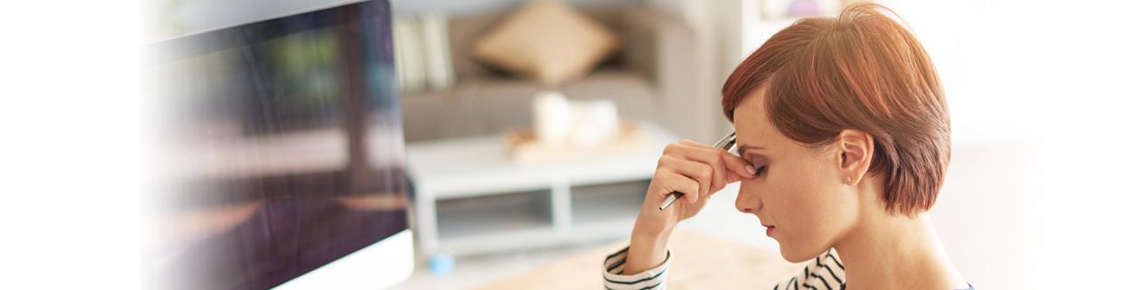stressed woman pinching bridge of nose